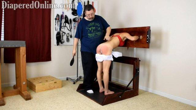 DiaperedOnline.com - Mia Spanked in Pillory [HD, 720p]