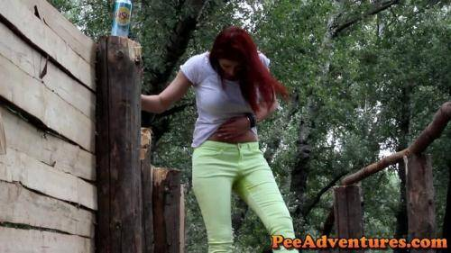 Wetting her lime jeans in the paint ball camp [FullHD, 1080p] [PeeAdventures.com] - Pissing