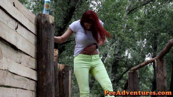 Wetting her lime jeans in the paint ball camp (PeeAdventures.com) [FullHD, 1080p]