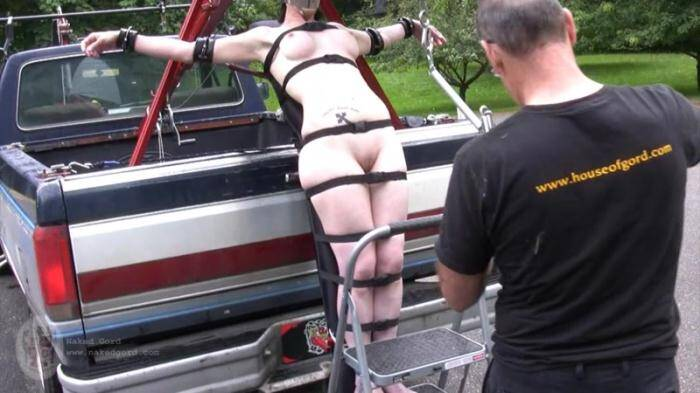Nakedgord.com - Tied to the truck (BDSM) [HD, 720p]