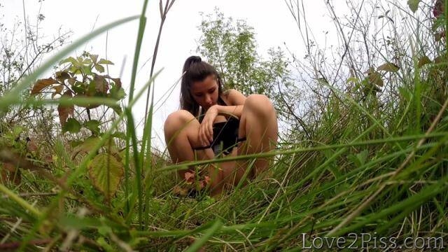Love2Piss.com - Pissing in the grass [FullHD, 1080p]