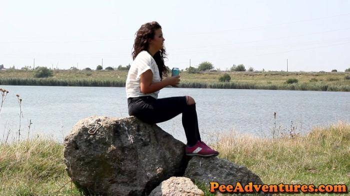 Desperate to pee on a rock near a lake [FullHD, 1080p] - PeeAdventures.com