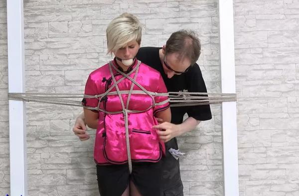Taylor fixed into 2 poles with a tight neck rope  [FullHD 1080p]