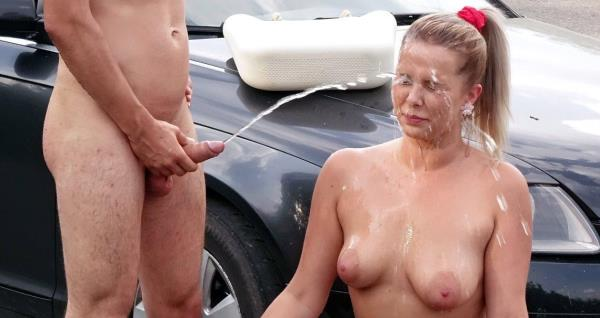 Hardcore pissing action on a parking lot (FullHD 1080p)